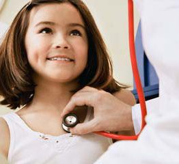 Young girl with a pediatrician --- Image by © Solus-Veer/Corbis